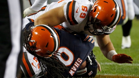 Cleveland Browns defensive back Calvin Pryor (25) and Cleveland Browns defensive end Karter Schult (69) sack Chicago Bears quarterback Connor Shaw (9) for safety during the second half of an NFL preseason football game, Thursday, Aug. 31, 2017, in Chicago. (AP Photo/Nam Y. Huh)