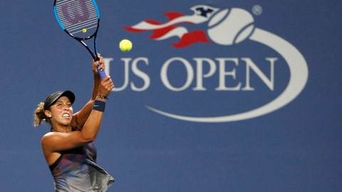 Madison Keys, of the United States, hits a return to Tatjana Maria, of Germany, at the U.S. Open tennis tournament in New York, Thursday, Aug. 31, 2017. (AP Photo/Kathy Willens)