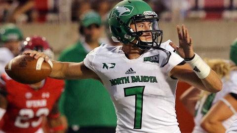 North Dakota quarterback Keaton Studsrud (7) passes the ball against Utah in the second half during an NCAA college football game Thursday, Aug. 31, 2017, in Salt Lake City. (AP Photo/Rick Bowmer)