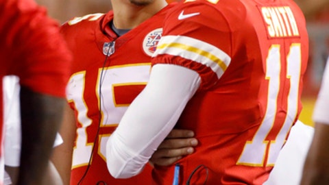 Kansas City Chiefs quarterback Patrick Mahomes (15) talks to quarterback Alex Smith (11) during the second half of an NFL preseason football game against the Tennessee Titans in Kansas City, Mo., Thursday, Aug. 31, 2017. (AP Photo/Colin E. Braley)