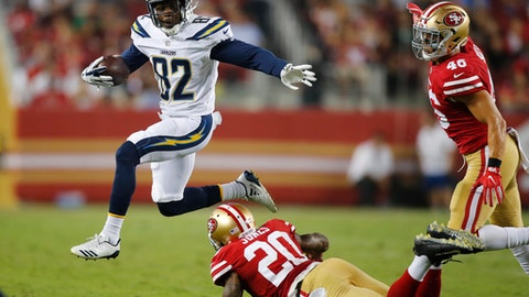 Los Angeles Chargers wide receiver Artavis Scott (82) leaps over San Francisco 49ers defensive back Don Jones (20) during the second half of a preseason NFL football game Thursday, Aug. 31, 2017, in Santa Clara, Calif. (AP Photo/John Hefti)