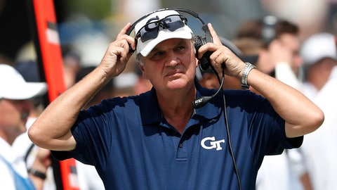 FILE - In this Sept. 17, 2016, file photo, Georgia Tech coach Paul Johnson adjusts his headset during the team's NCAA college football game against Vanderbilt in Atlanta. Johnson heads into his 10th season as Georgia Tech's coach, which is rare territory indeed in today's instant-gratification world. (AP Photo/John Bazemore, File)