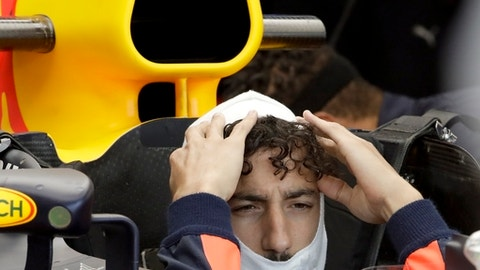 Red Bull driver Daniel Ricciardo of Australia sits in his car during the second free practice for Sunday's Italian Formula One Grand Prix, at the Monza racetrack, Italy, Friday, Sept.1, 2017. (AP Photo/Antonio Calanni)