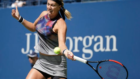 Petra Kvitova, of the Czech Republic, returns a shot from Caroline Garcia, of France, during the third round of the U.S. Open tennis tournament, Friday, Sept. 1, 2017, in New York. (AP Photo/Seth Wenig)