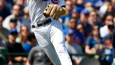 Chicago Cubs third baseman Kris Bryant (17) makes a throw to first base for an out on a ball hit by Atlanta Braves catcher Kurt Suzuki during the second inning of a baseball game Friday, Sept. 1, 2017, in Chicago. (AP Photo/Jim Young)