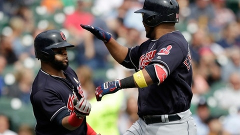Cleveland Indians designated hitter Edwin Encarnacion, right, is congratulated by Carlos Santana after hitting a solo home run during the sixth inning of the first game of a baseball doubleheader against the Detroit Tigers, Friday, Sept. 1, 2017, in Detroit. (AP Photo/Carlos Osorio)