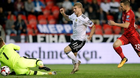 Germany's Timo Werner, center, scores the opening goal during the World Cup Group C qualifying soccer match between Czech Republic and Germany in Prague, Czech Republic, Friday, Sept. 1, 2017. (AP Photo/Petr David Josek)