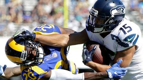 FILE - In this Sept. 18, 2016, file photo, Seattle Seahawks wide receiver Jermaine Kearse, right, pushes Los Angeles Rams cornerback Lamarcus Joyner as he runs the ball during the second half of an NFL football game in Los Angeles. The Seahawks have acquired defensive tackle Sheldon Richardson from the New York Jets in exchange for Kearse and a second-round draft pick. (AP Photo/Jae Hong, File)