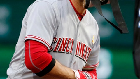Cincinnati Reds' Joey Votto stands on second base after an RBI double off Pittsburgh Pirates starting pitcher Gerrit Cole in the first inning of a baseball game in Pittsburgh, Friday, Sept. 1, 2017. (AP Photo/Gene J. Puskar)