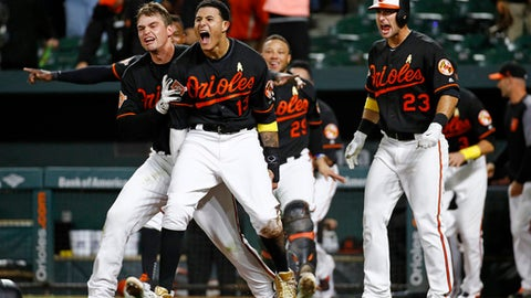 Baltimore Orioles' Manny Machado (13) celebrates with teammates after scoring on Jonathan Schoop's double in the 13th inning of a baseball game against the Toronto Blue Jays in Baltimore, Friday, Sept. 1, 2017. Baltimore won 1-0. (AP Photo/Patrick Semansky)