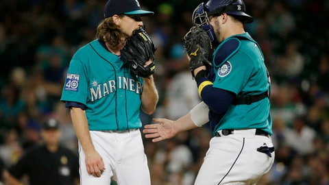 Seattle Mariners starting pitcher Mike Leake, left, talks with catcher Mike Zunino, right, during the seventh inning of a baseball game against the Oakland Athletics, Friday, Sept. 1, 2017, in Seattle. (AP Photo/Ted S. Warren)