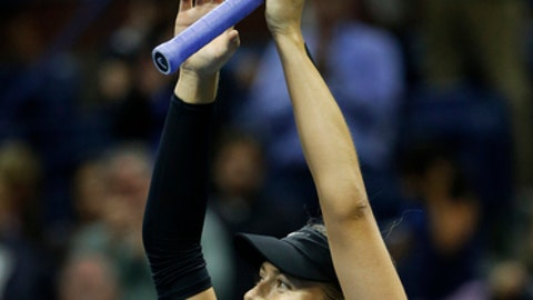 Mari Sharapova, of Russia, waves to the crowd after defeating Sofia Kenin, of the United States, 7-5, 6-2 at the U.S. Open tennis tournament in New York, Friday, Sept. 1, 2017. (AP Photo/Kathy Willens)