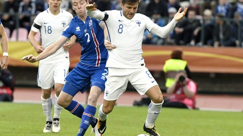 Finland's Perparim Hetemaj, right, battles for the ball with Iceland's Birkir Saevarsson during their World Cup Group I qualifying soccer match in Tampere, Finland, Saturday, Sept. 2, 2017. (Jussi Nukari/Lehtikuva via AP)