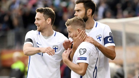 Finland's Alexander Ring, center, celebrates his goal with teammates Kasper Hamalainen, left, and Tim Sparv during their World Cup Group I qualifying soccer match against Iceland in Tampere, Finland, Saturday, Sept. 2, 2017. (Jussi Nukari/Lehtikuva via AP)