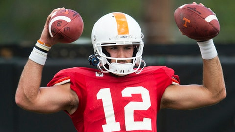 """FILE - In this Aug. 15, 2017, file photo, Tennessee quarterback Quinten Dormady takes part in an NCAA college football practice in Knoxville, Tenn. Tennessee head coach Butch Jones says he has a """"pretty good idea"""" which of his quarterbacks will start Monday's season opener with Georgia Tech, but he doesn't want to announce his choice. (Caitie McMekin/Knoxville News Sentinel via AP, File)"""
