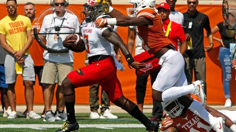Maryland quarterback Tyrrell Pigrome, left, runs for a touchdown against Texas defensive back Kris Boyd, right, during the first half of an NCAA college football game, Saturday, Sept. 2, 2017, in Austin, Texas. (AP Photo/Michael Thomas)