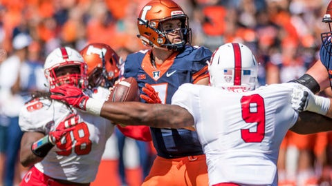 Illinois quarterback Chayce Crouch (7) looks to throw the ball while under pressure from Ball State defensive ends Reggie McGee (9) and Anthony Winbush (98) during the first quarter of an NCAA college football game Saturday, Sept. 2, 2017, at Memorial Stadium in Champaign, Ill. (AP Photo/Bradley Leeb)