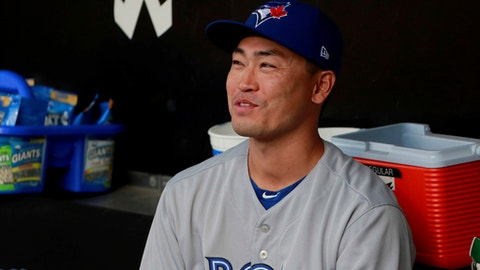 FILE - In this Aug. 1, 2017, file photo, Toronto Blue Jays' Nori Aoki sits in the dugout before his first game with the team, against the Chicago White Sox in Chicago. Outfielder Nori Aoki agreed to a contract with the New York Mets on Saturday, Sept. 2, 2017, and was expected to join the team before its game at Houston. Aoki had a $5.5 million, one-year contract and was released Tuesday by Toronto.  (AP Photo/Jeff Haynes, File)
