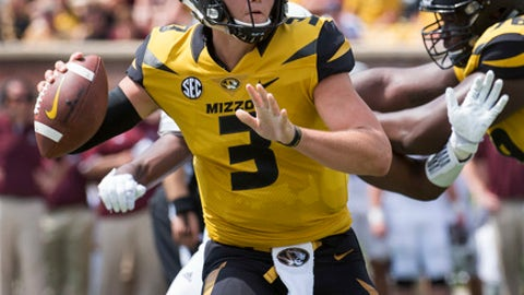Missouri quarterback Drew Lock scrambles as he throws the ball during the third quarter of an NCAA college football game against Missouri State Saturday, Sept. 2, 2017, in Columbia, Mo. (AP Photo/L.G. Patterson)