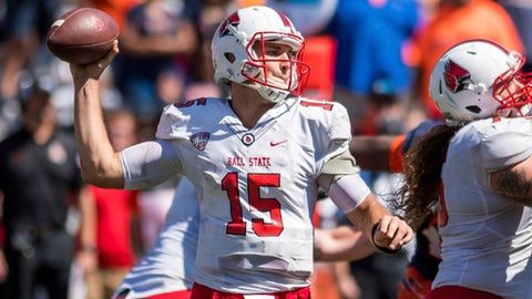 Ball State quarterback Riley Neal (15) throws the ball during the fourth quarter of an NCAA college football game against Illinois Saturday, Sept. 2, 2017 at Memorial Stadium in Champaign, Ill. Illinois won 24-21. (AP Photo/Bradley Leeb)