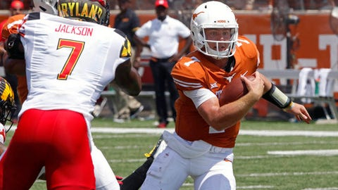 Texas quarterback Shane Buechele, right, runs the ball against Maryland defensive back JC Jackson, left, during the second half of an NCAA college football game, Sept. 2, 2017 in Austin, Texas. Maryland won 51-41. (AP Photo/Michael Thomas)