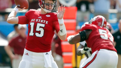 North Carolina State's Ryan Finley (15) aims a pass against the South Carolina defense during the first half of a college football game in Charlotte, N.C., Saturday, Sept. 2, 2017. (AP Photo/Bob Leverone)