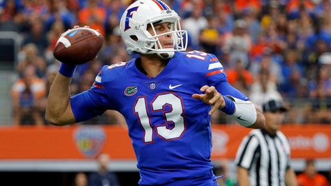 Florida quarterback Feleipe Franks (13) throws a pass in the first half of an NCAA college football game against Michigan, Saturday, Sept. 2, 2017, in Arlington, Texas. (AP Photo/Tony Gutierrez)