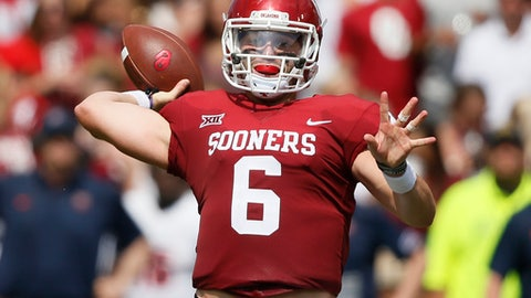 Oklahoma quarterback Baker Mayfield (6) throws a touchdown pass to tight end Grant Calcaterra in the second quarter of an NCAA college football game against UTEP in Norman, Okla., Saturday, Sept. 2, 2017. (AP Photo/Sue Ogrocki)