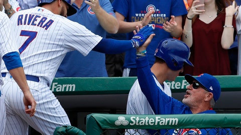 Chicago Cubs' Rene Rivera celebrates his grand slam home run against the Atlanta Braves with Cubs' manager Joe Maddon during the second inning of a baseball game Saturday, Sept. 2, 2017, in Chicago. (AP Photo/Jim Young)