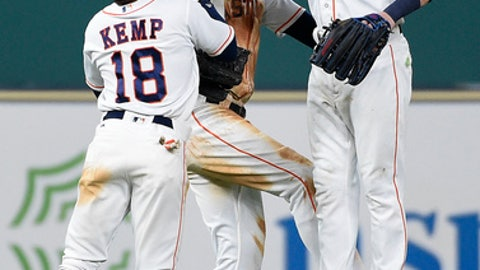 Houston Astros' Tony Kemp (18), Cameron Maybin, center, and Josh Reddick celebrate the team's win over the New York Mets in the first game of a baseball doubleheader, Saturday, Sept. 2, 2017, in Houston. Houston won 12-8. (AP Photo/Eric Christian Smith)