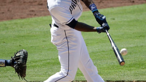 San Diego Padres' Jabari Blash hits an RBI single during the sixth inning of a baseball game against the Los Angeles Dodgers, Saturday, Sept. 2, 2017, in San Diego. (AP Photo/Jae C. Hong)