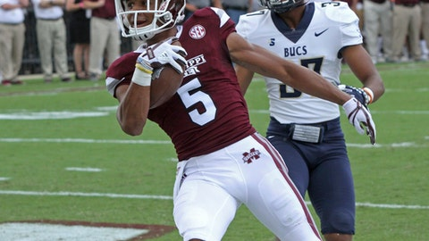 Mississippi State wide receiver Gabe Myles (5) catches a pass for a touchdown ahead of Charleston Southern defensive back Sekwan Jenkins (37) during the first half of an NCAA college football game in Starkville, Miss., Saturday, Sept. 2, 2017. (AP Photo/Jim Lytle)