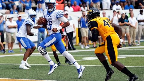 Kentucky quarterback Stephen Johnson (15) sprints past Southern Mississippi linebacker Racheem Boothe (41) for a first half touchdown during a NCAA college football game in Hattiesburg, Miss., Saturday, Sept. 2, 2017. (AP Photo/Rogelio V. Solis)