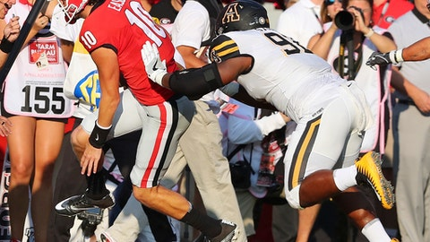 Georgia quarterback Jacob Eason is pushed out of bounds by Appalachian State defender Myquon Stout, who was penalized on the play during the first quarter of an NCAA college football game Saturday, Sept. 2, 2017, in Athens, Ga. Eason left the game. (Curtis Compton/Atlanta Journal-Constitution via AP)