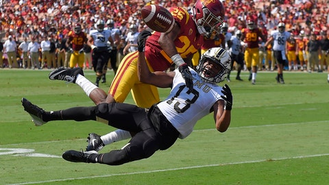 Western Michigan wide receiver Keishawn Watson, below, cannot get to a pass intended for him as Southern California cornerback Jack Jones defends during the first half of an NCAA college football game, Saturday, Sept. 2, 2017, in Los Angeles. Jones was called for pass interference on the play. (AP Photo/Mark J. Terrill)