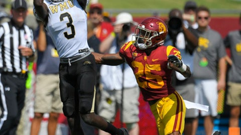 Western Michigan wide receiver Rodney Graves, left, catches a pass as Southern California cornerback Jack Jones defends during the first half of an NCAA college football game, Saturday, Sept. 2, 2017, in Los Angeles. (AP Photo/Mark J. Terrill)