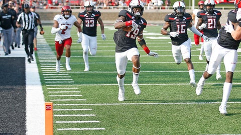 Texas Tech's Willie Sykes (19) runs to the end zone after intercepting the pass during an NCAA college football game against Eastern Washington, Saturday, Sept. 2, 2017, in Lubbock, Texas. (Brad Tollefson/Lubbock Avalanche-Journal via AP)