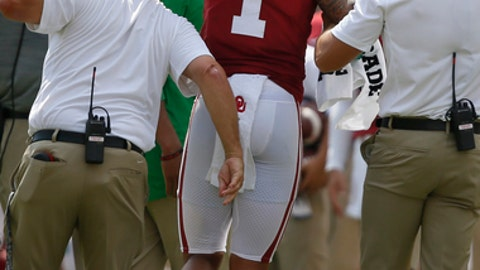 Oklahoma's Jordan Parker (1) is helped off the field after an injury in the first quarter of an NCAA college football game against UTEP in Norman, Okla., Saturday, Sept. 2, 2017. Oklahoma won 56-7. (AP Photo/Sue Ogrocki)