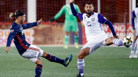 New England Revolution's Lee Nguyen, left, kicks the ball past Orlando City SC's Antonio Nocerino during the first half of an MLS soccer game in Foxborough, Mass., Saturday, Sept. 2, 2017. (AP Photo/Michael Dwyer)