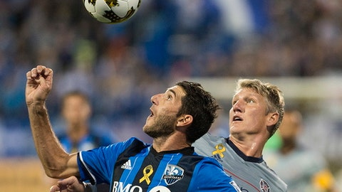 Montreal Impact's Ignacio Piatti, left, and Chicago Fire's Bastian Schweinsteiger challenge for the ball during the first half of an MLS soccer match in Montreal, Saturday, Sept. 2, 2017. (Graham Hughes/The Canadian Press via AP)