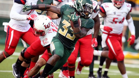 Baylor running back Jamycal Hasty scores past Liberty safety Brandon Tillmon, left, in the first half of an NCAA college football game, Saturday, Sept. 2, 2017, in Waco, Texas. (Rod Aydelotte/Waco Tribune Herald, via AP)