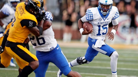 Kentucky quarterback Stephen Johnson (15) runs around his blocker running back Benjamin Snell Jr. (26) who is tying up Southern Mississippi defensive back Cornell Armstrong (3) as he looks for an open receiver during the second half of an NCAA college football game against Southern Mississippi in Hattiesburg, Miss., Saturday, Sept. 2, 2017. Kentucky won 24-17. (AP Photo/Rogelio V. Solis)