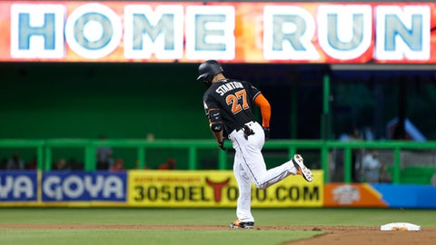 Miami Marlins' Giancarlo Stanton rounds second base after hitting a home run during the first inning of a baseball game against the Philadelphia Phillies, Saturday, Sept. 2, 2017, in Miami. (AP Photo/Wilfredo Lee)