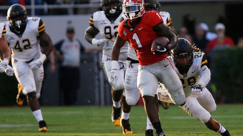 Georgia tailback Sony Michel (1) drives the ball down the field in the first half NCAA college football game between Georgia and Appalachian State in Athens, Ga., Saturday, Sept. 2, 2017. (Joshua L. Jones/Athens Banner-Herald via AP)