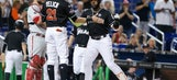 Stanton hits 52nd homer as Marlins top Phillies 10-9