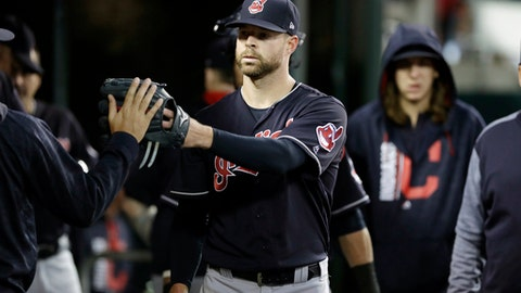 Cleveland Indians starting pitcher Corey Kluber is greeted in the dugout after the sixth inning of a baseball game against the Detroit Tigers, Saturday, Sept. 2, 2017, in Detroit. (AP Photo/Carlos Osorio)