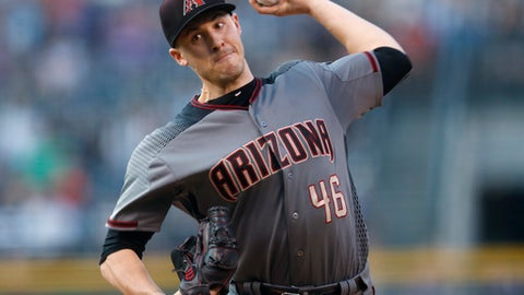 Arizona Diamondbacks starting pitcher Patrick Corbin delivers to Colorado Rockies' Charlie Blackmon in the first inning of a baseball game Saturday, Sept. 2, 2017, in Denver. (AP Photo/David Zalubowski)