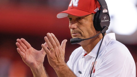 Nebraska head coach Mike Riley applauds after a play review confirmed a touchdown by wide receiver Stanley Morgan Jr. during the first half of an NCAA college football game against Arkansas State in Lincoln, Neb., Saturday, Sept. 2, 2017. (AP Photo/Nati Harnik)
