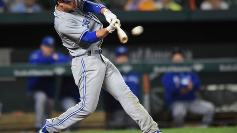 Toronto Blue Jays' Darwin Barney connects for a double against the Baltimore Orioles in the seventh inning of a baseball game, Saturday, Sept. 2, 2017, in Baltimore. (AP Photo/Gail Burton)