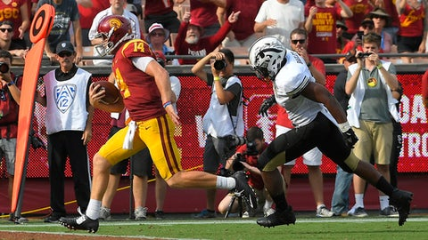 Southern California quarterback Sam Darnold, left, runs in for a touchdown as Western Michigan linebacker Caleb Bailey pursues during the second half of an NCAA college football game, Saturday, Sept. 2, 2017, in Los Angeles. (AP Photo/Mark J. Terrill)